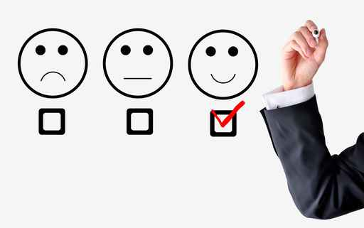 Customer satisfaction concept with businessman hand drawing smil